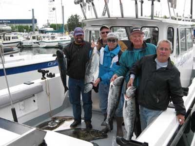 Fishing group with salmon - Big Blue Charters, Alaska