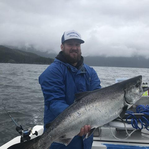 Fishing trip guest with large Alaska Salmon