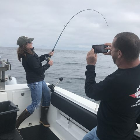 Reeling in big fish with Big Blue Charters in Alaska