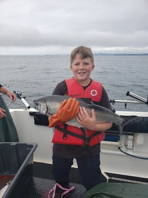 August 17,2019 - Big Blue Charters fisherman with large Alaska salmon.